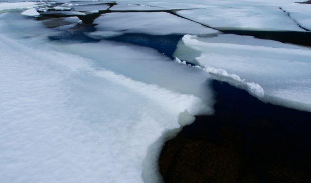 Ice on the tarn below the summit