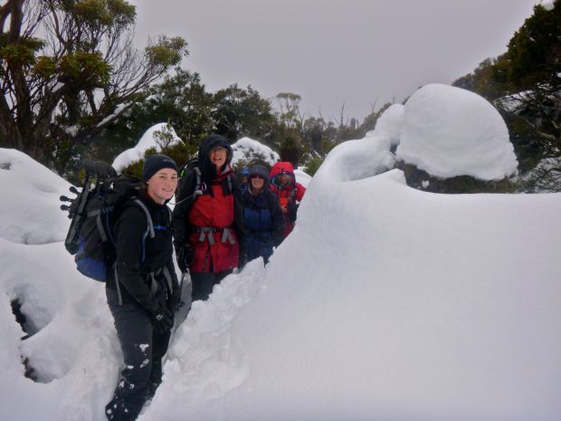 The crew, standing in our 'snow trench' agree to turn back..