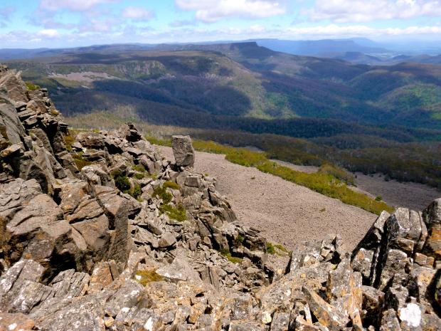 Projection bluff, scree field below, along the final ridge to the summit