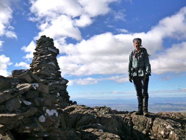 The second summit cairn and Urszula.. she makes it look smaller than it is!
