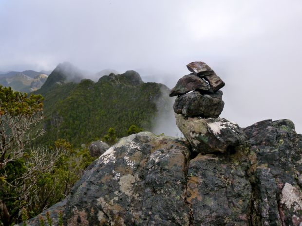 One of the cairns marking the way. You can see the wall of mist down the right hand side of the range