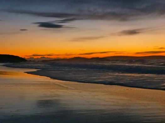A hint of colour marks the dawn of a new day, as I head for the rocks on the left.