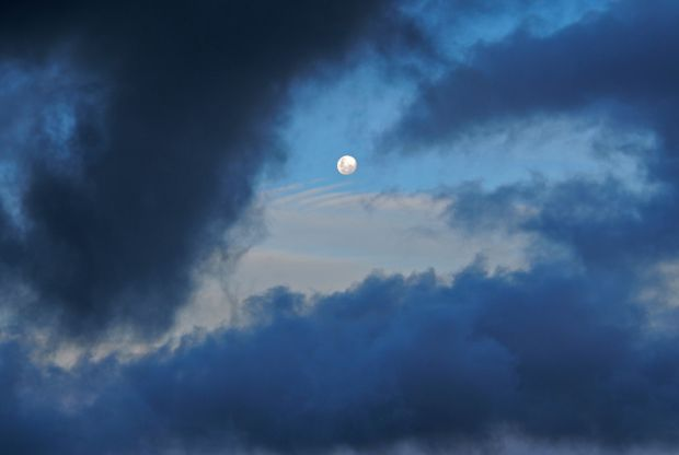 For just a moment, before being engulfed, the moon smiles down :D