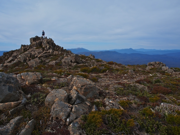 A short climb up scree, and Ben finds the slightly lower summit of Mueller East