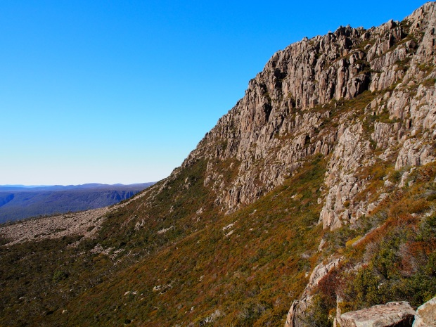 Part way down the scree, looking south, Bastion summit up to the right.