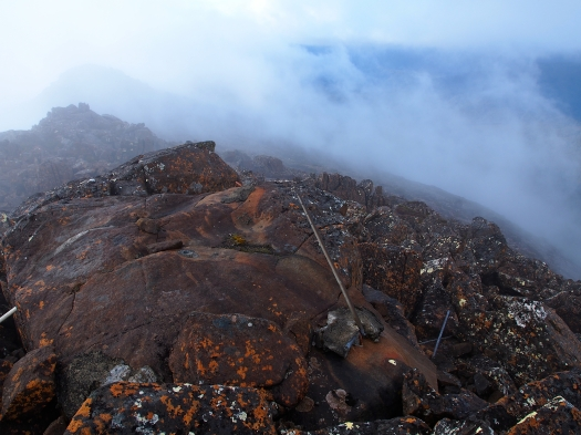 The summit from the highest rock, and what is left of the trig.