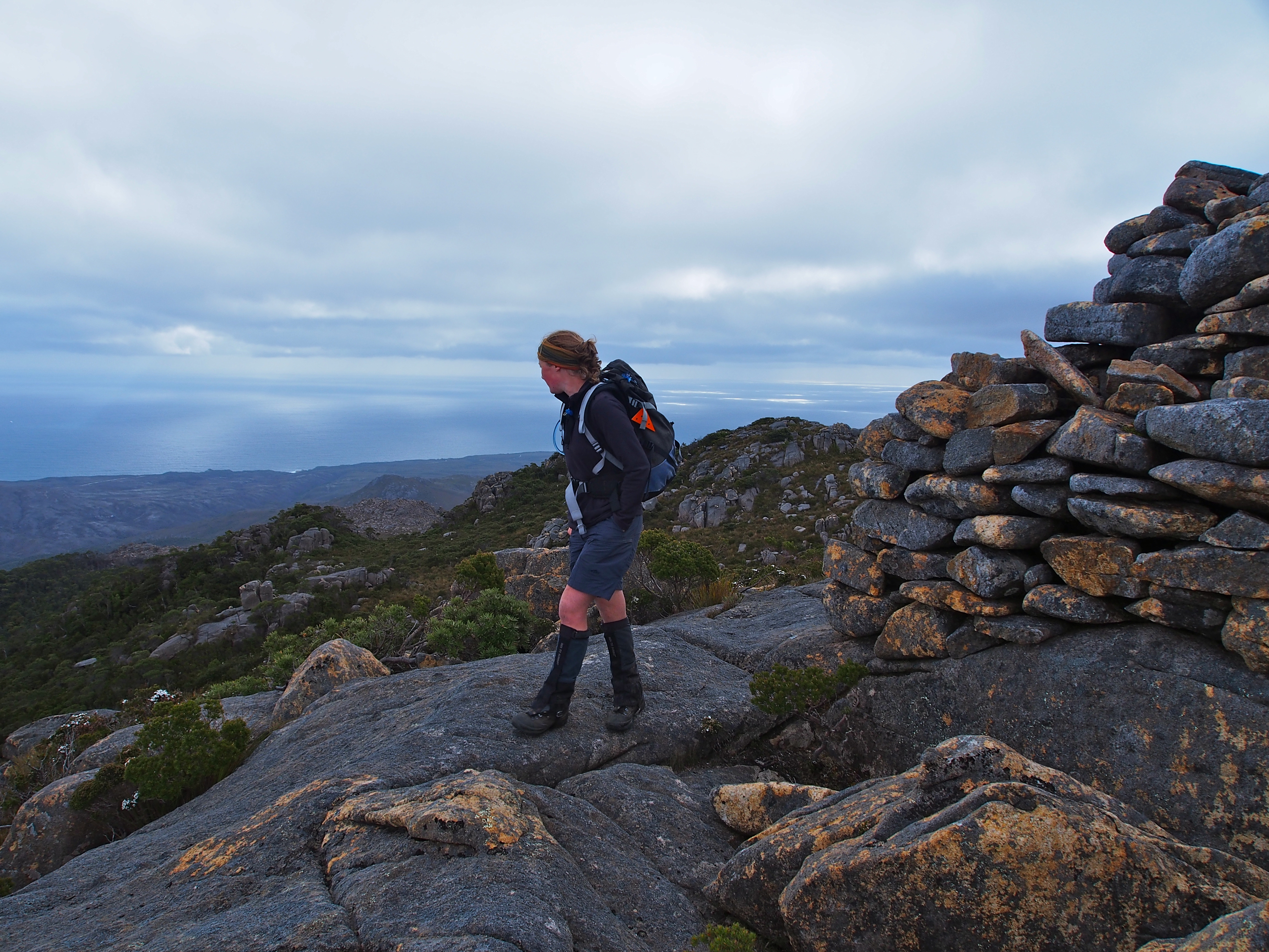 Lingering for a moment by the cairn, before moving to the true and unmarked summit