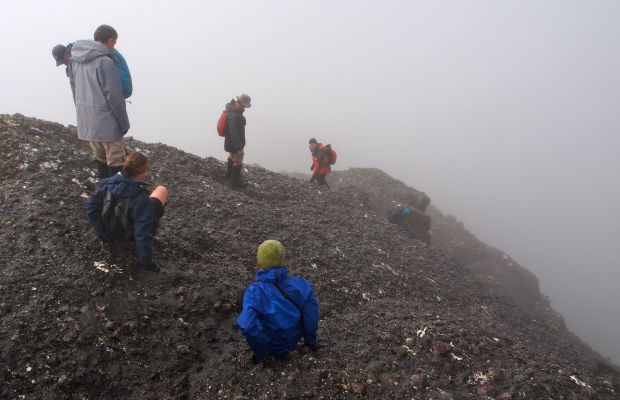Time to head back down, into the mist and beyond.. just for a bit of perspective on the slant of the summit rock ;)