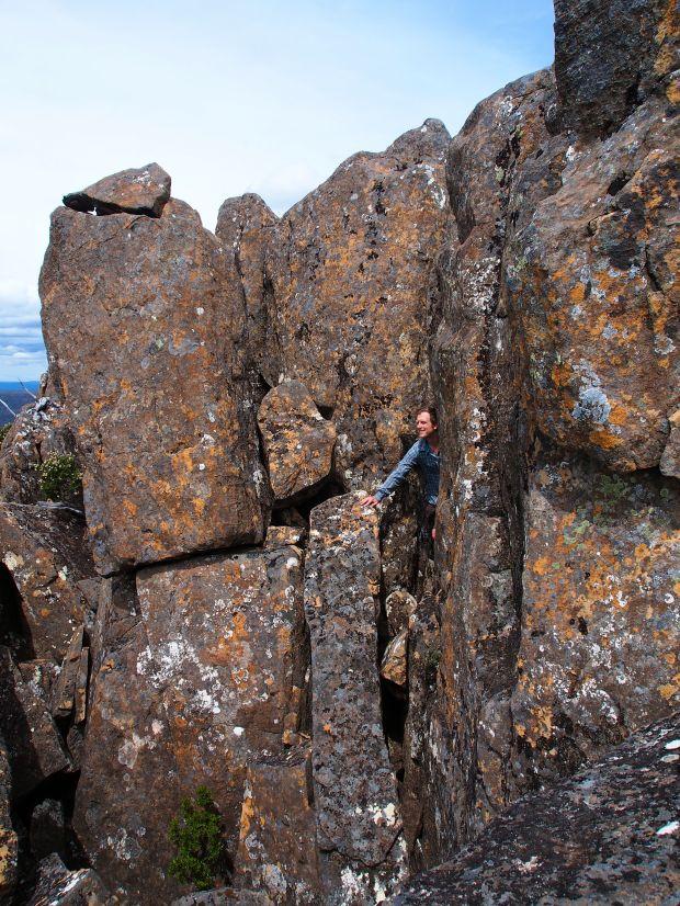 Ben has fun exploring cracks in the rocks