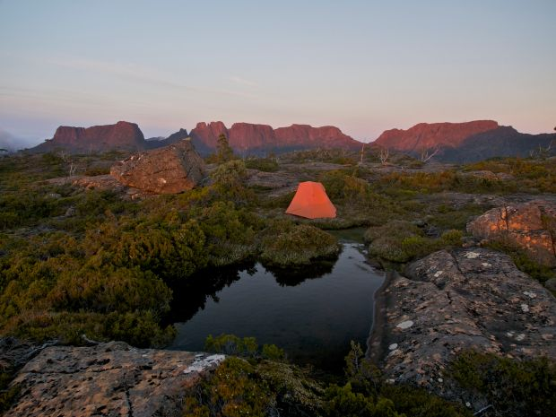 The sun promises warmth as long rays tentatively fall on mountain tops. My tent is at home here.