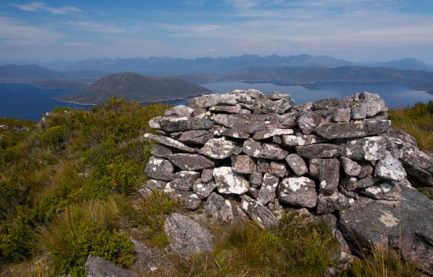 Solitary summit cairn, Western Arthurs behind.