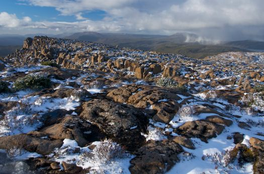 Looking north from the summit, a snow flurry sits over the Walls of Jerusalem