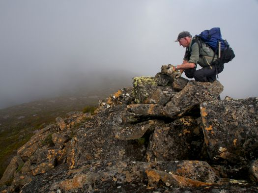 Graham adds to the little cairn on Little Sugarloaf