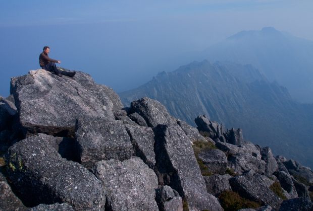 John enjoys the summit of Reeds Peak, while the haze from bushfires starts to clear, and we can see across to Bonds Crag