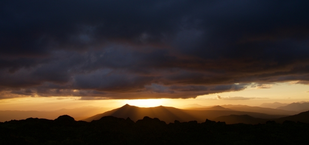 Sun setting behind Goulds Sugarloaf - no sign of the fire that's out that way, and we hope that's a good sign