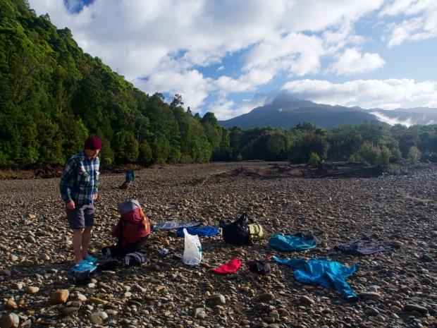 John and I try to get a bit dry as we wait for Graham. Eldon Peak looks on.